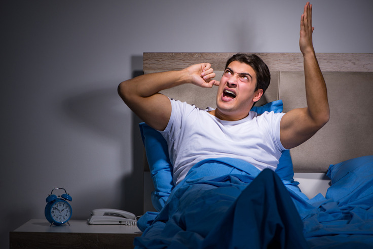 man cannot sleep because of noisy neighbour