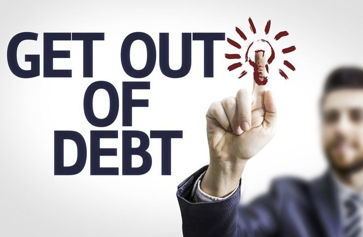 Man writing 'get out of debt'