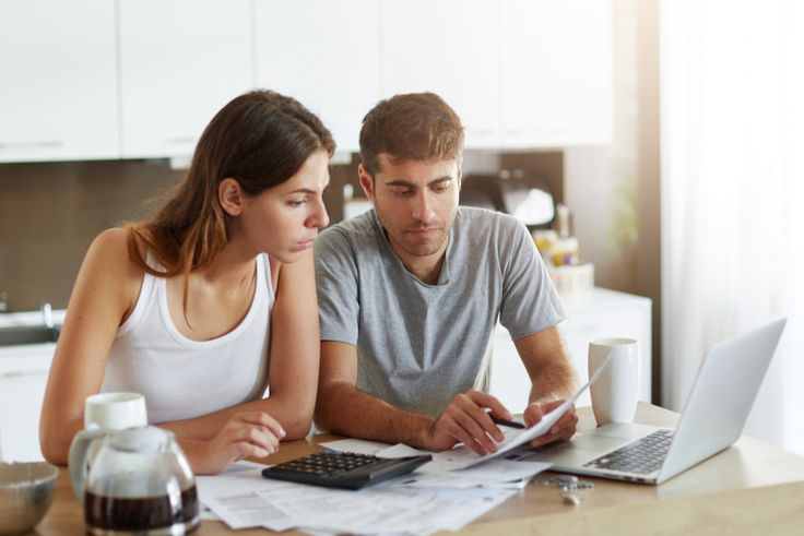 couple struggling to pay off debts